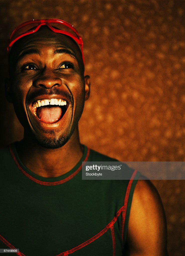 close-up of a man standing with his mouth wide open : Stock Photo