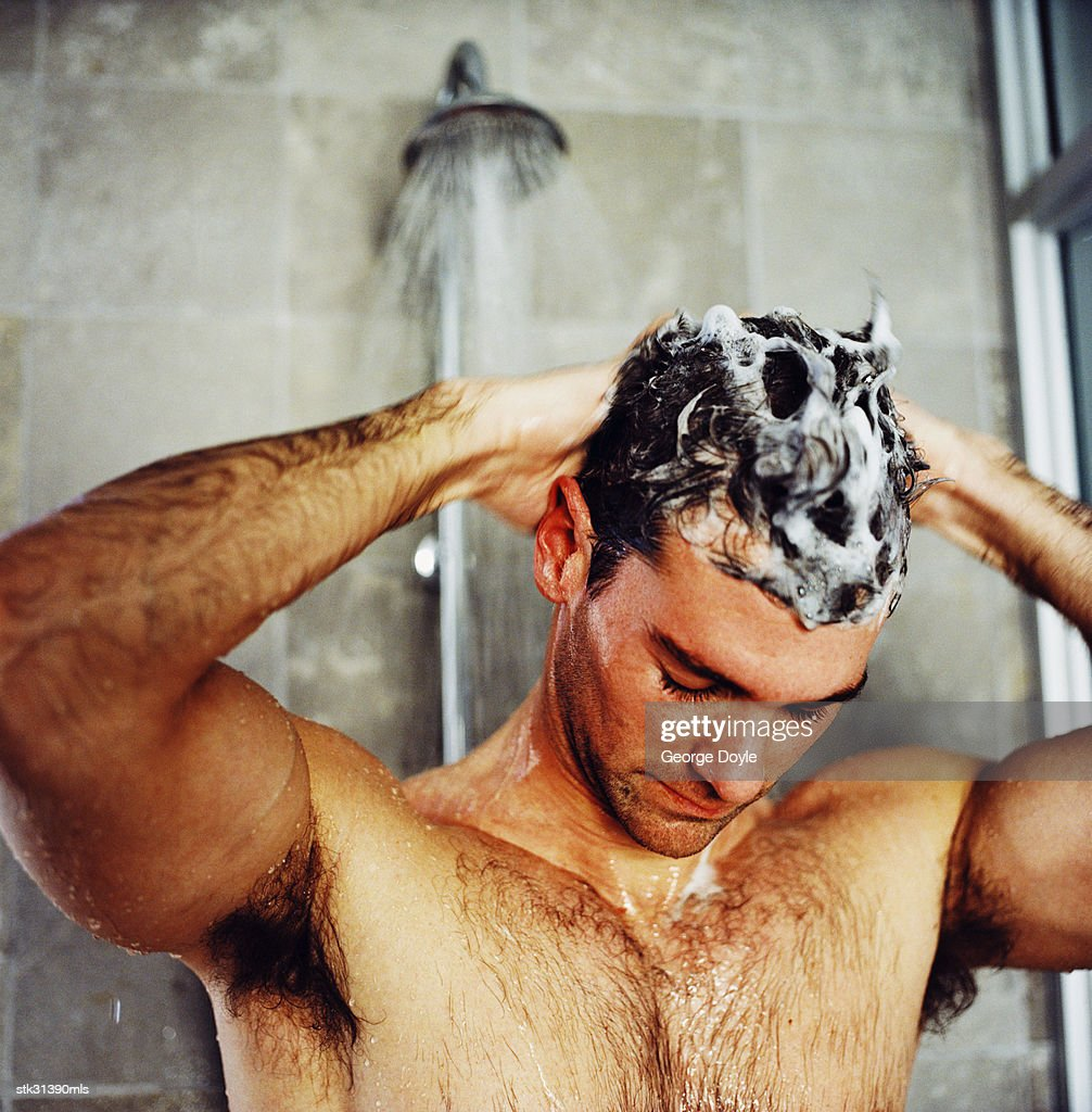close-up of a man washing his hair in the shower : ストックフォト