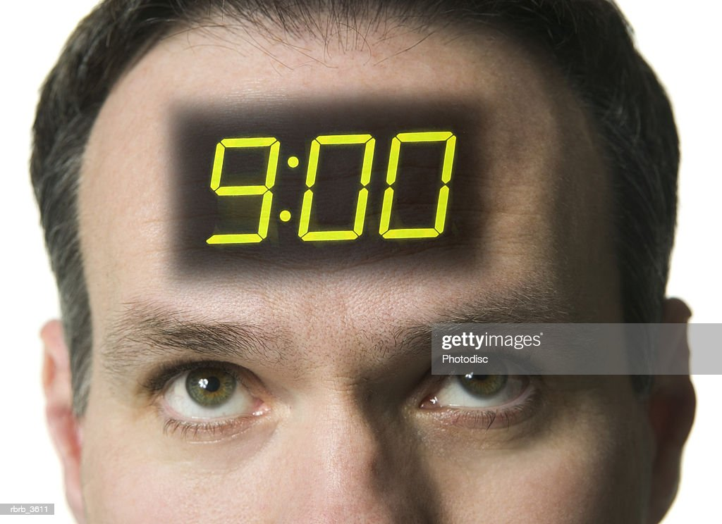Close-up of a man with a digital clock on his forehead : Stockfoto