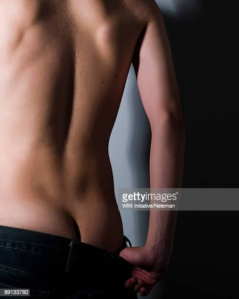 close-up of a man's back - builders bum stock pictures, royalty-free photos & images
