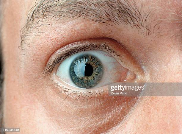 close-up of a man's eye - staring stock photos and pictures