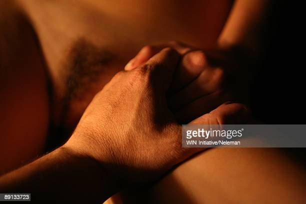 close-up of a man's hand holding woman's hand - femme poil photos et images de collection