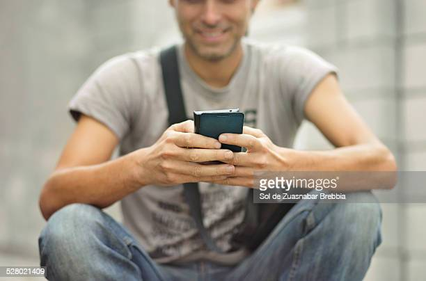 Closeup of a man's hands holding a mobile phone