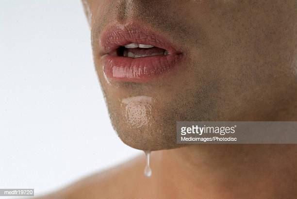 close-up of a man's mouth - pores stock photos and pictures