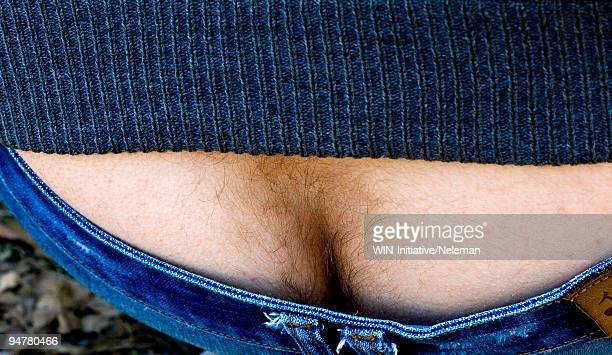 close-up of a man's plumber's crack - rear end stock photos and pictures