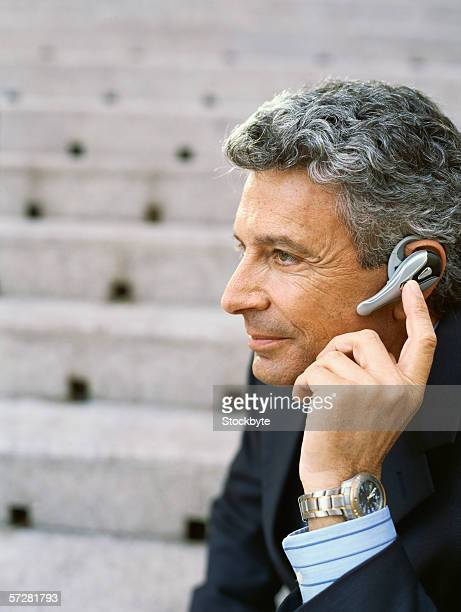 Close-up of a mature businessman wearing a headset