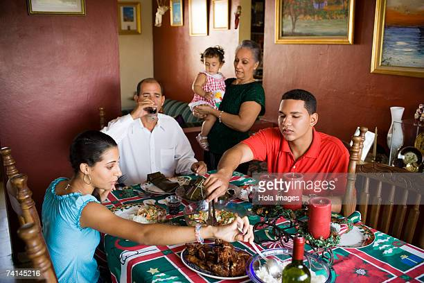 close-up of a mature couple and their children at the dining table - dominican ethnicity stock photos and pictures