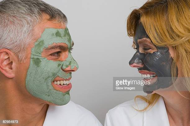 Close-up of a mature couple wearing facial masks and smiling