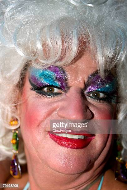 close-up of a mature gay man smiling - transvestite stock photos and pictures