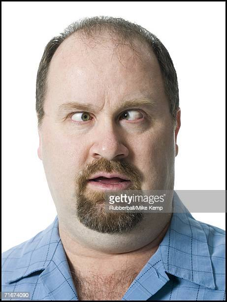 close-up of a mature man looking cross eyed - fat bald men stock pictures, royalty-free photos & images