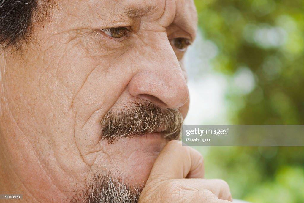 Close-up of a mature man looking serious : Stock Photo