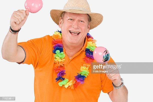 close-up of a mature man playing maracas - maraca stock photos and pictures