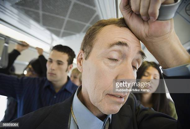 Close-up of a mature man traveling in a passenger train