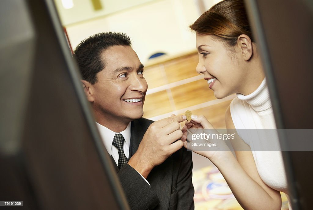 Close-up of a mature man with his daughter looking at each other and smiling : Foto de stock