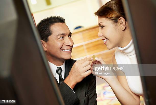 close-up of a mature man with his daughter looking at each other and smiling - teen pokies stock photos and pictures