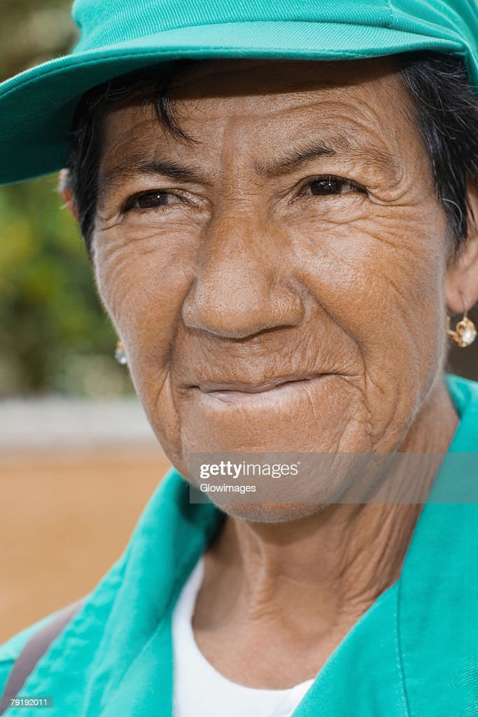 Close-up of a mature woman smiling : Stock Photo