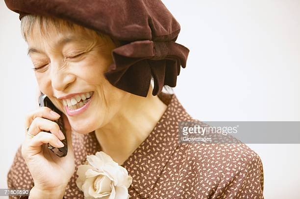 Close-up of a mature woman talking on a mobile phone