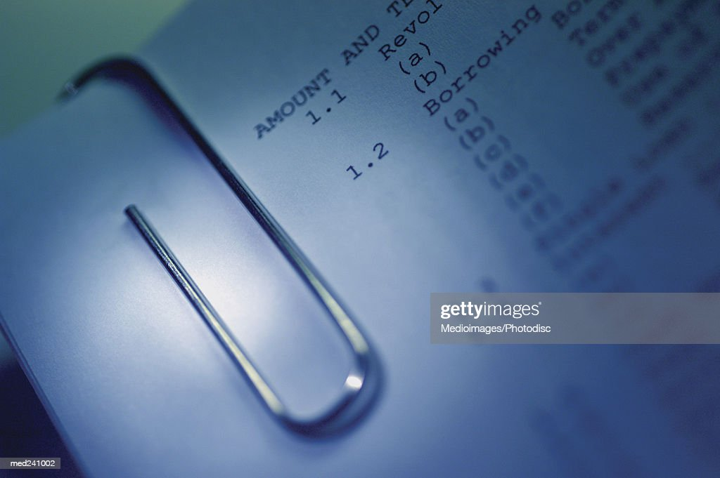 Close-up of a metallic paper clip : Stock Photo