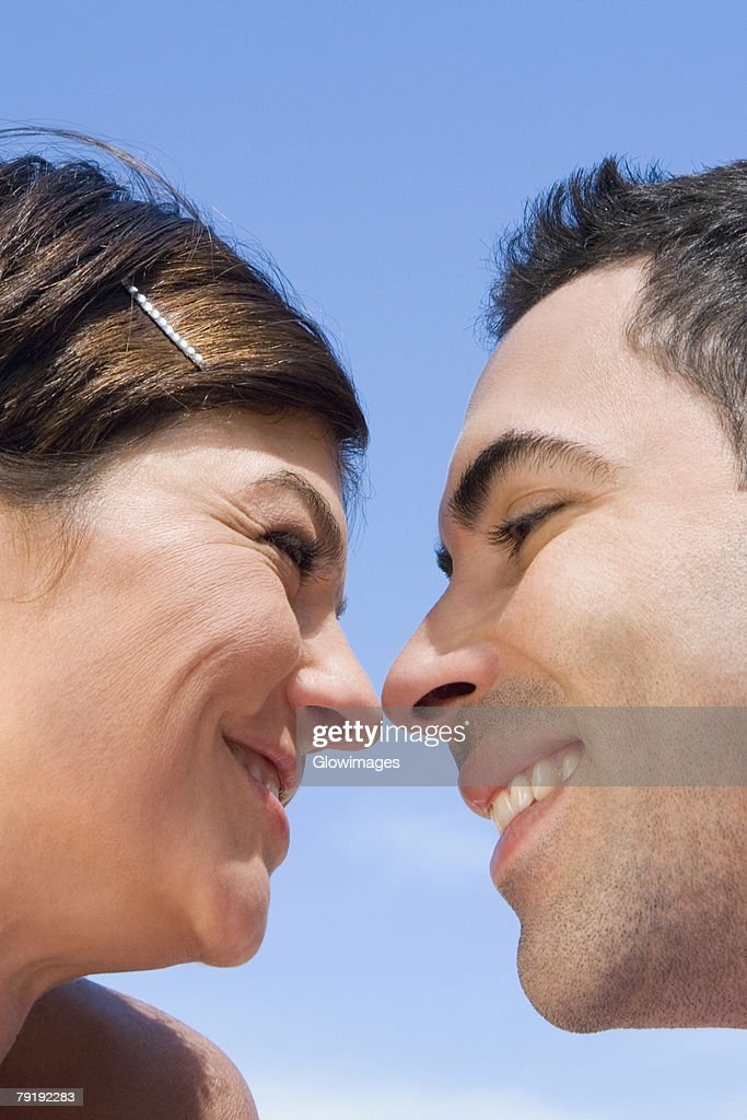Close-up of a mid adult couple looking at each other with smiling : Stock Photo