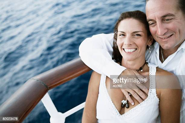 Close-up of a mid adult couple romancing in a ship