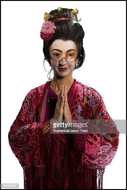 close-up of a mid adult woman in a japanese geisha costume - prayer pose greeting bildbanksfoton och bilder
