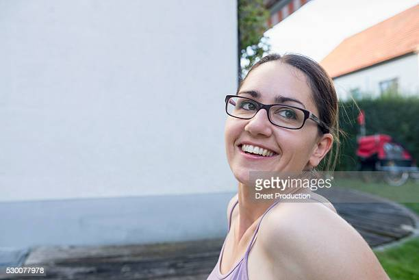 Close-up of a mid adult woman wearing eyeglasses and smiling, Munich, Bavaria, Germany