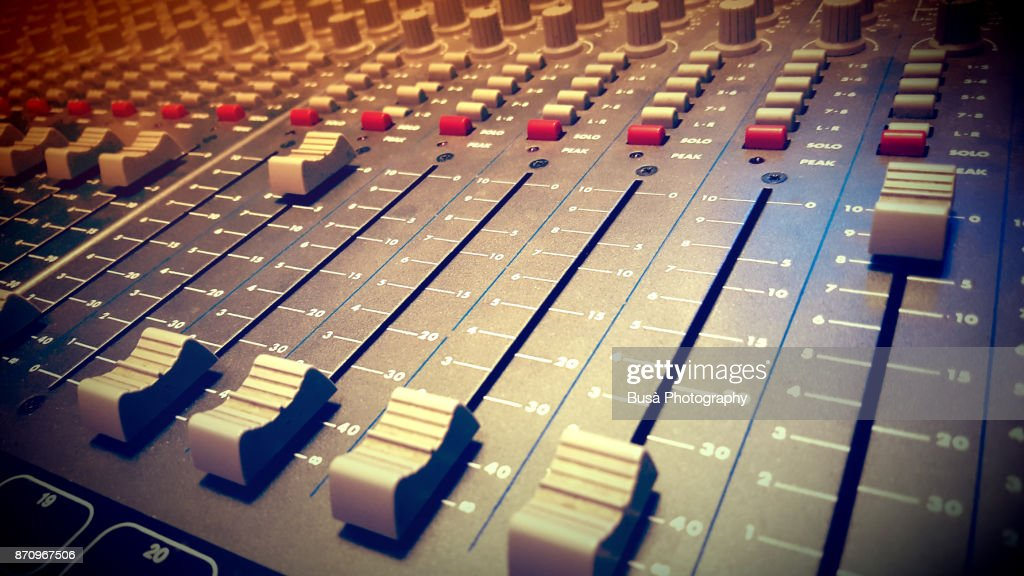 Closeup of a mixing desk in a recording studio : Stock Photo