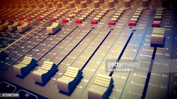 Closeup of a mixing desk in a recording studio