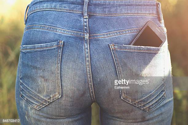 close-up of a mobile phone in a back pocket - pocket stock photos and pictures