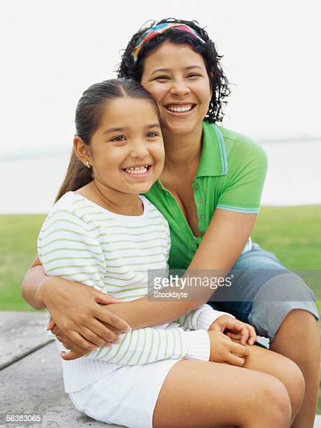 close-up of a mother embracing her daughter - cleavage stock pictures, royalty-free photos & images