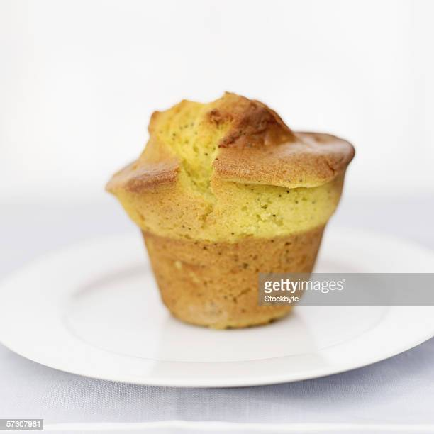close-up of a muffin on a plate - oriental poppy stock pictures, royalty-free photos & images