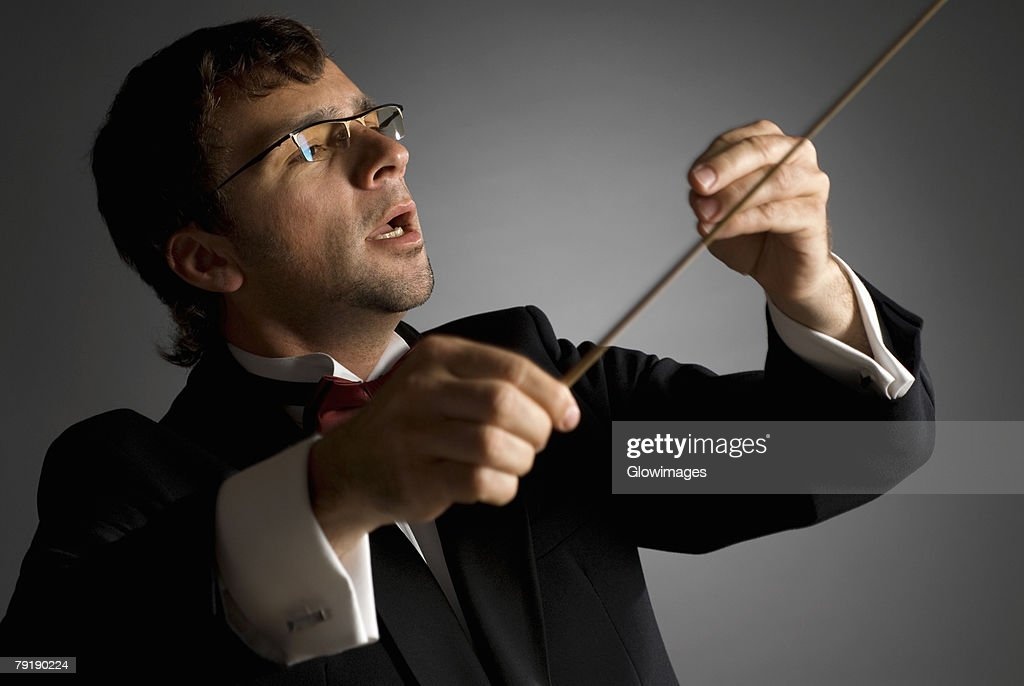 Close-up of a music conductor performing : Foto de stock