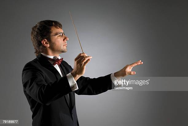 close-up of a musician holding a conductor's baton - 指揮者 ストックフォトと画像