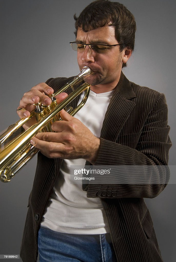 Close-up of a musician playing a trumpet : Stock Photo