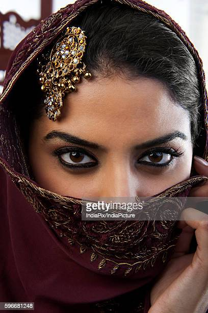 close-up of a muslim womans eyes - dupatta stock pictures, royalty-free photos & images