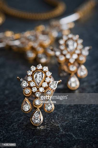 close-up of a necklace with a pair of earrings - necklace stock pictures, royalty-free photos & images