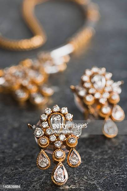Close-up of a necklace with a pair of earrings