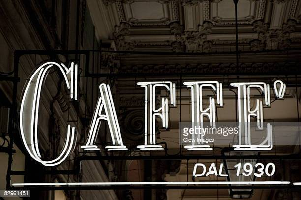 Close-up of a neon cafe sign at a door, Genoa, Italy
