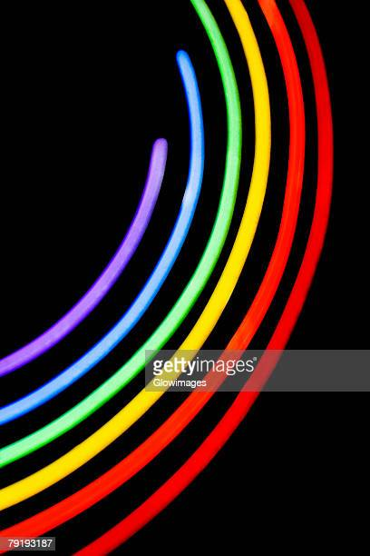 Close-up of a neon illuminating gay pride symbol