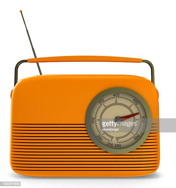 Close-up of a orange retro radio with a clipping path