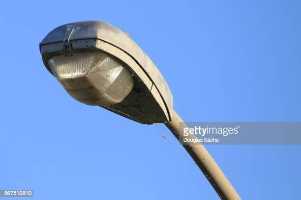 Close-up of a overhead street light on a pole