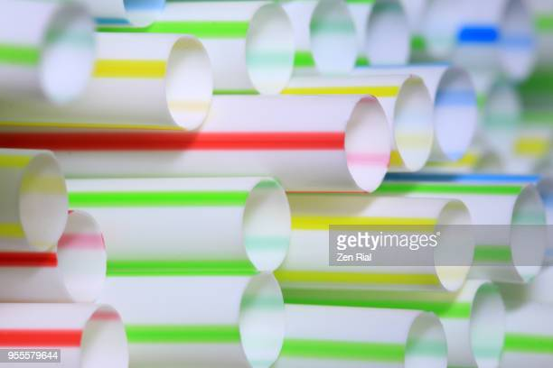 Close-up of a pack of multicolored plastic drinking straws showing ends