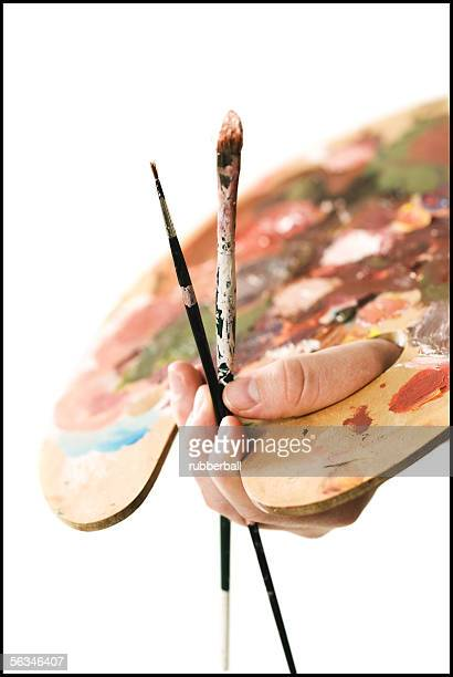 close-up of a paint palette in a person's hand - paleta de cores imagens e fotografias de stock
