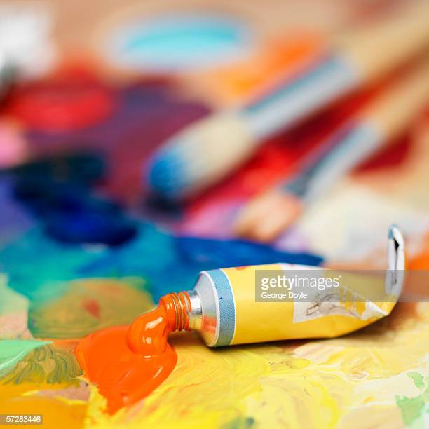 Close-up of a paint tube and brushes