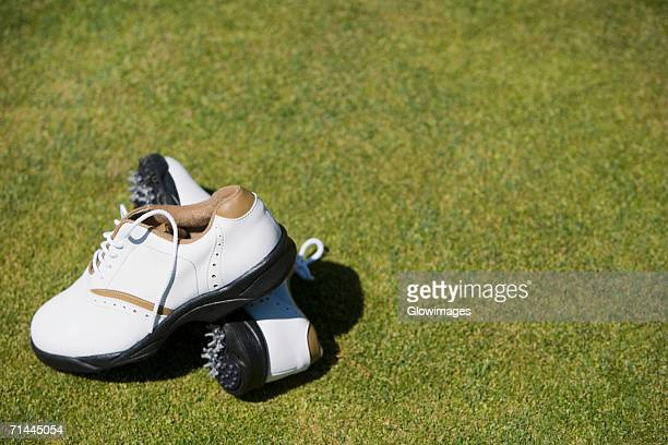 Close-up of a pair of golf shoes on the grass