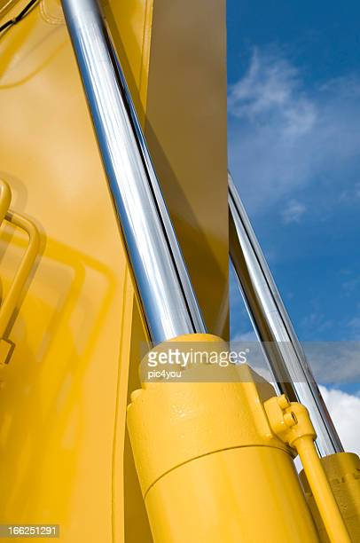 Close-up of a part of a yellow excavator