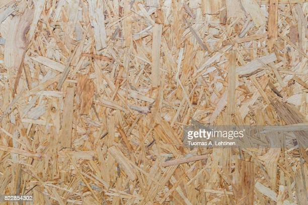 Close-up of a particle board background texture.