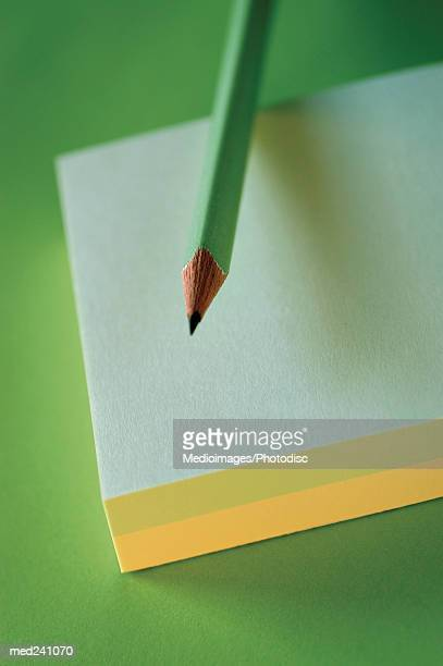 Close-up of a pencil on a notebook