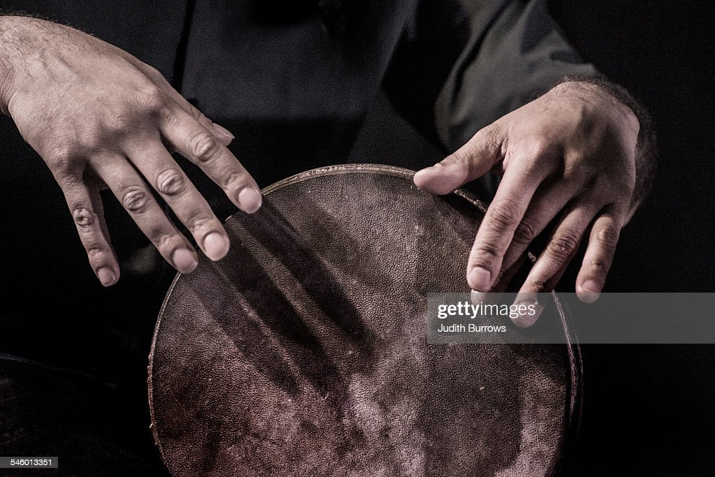 A close-up of a percussion player's hands, circa 2012.