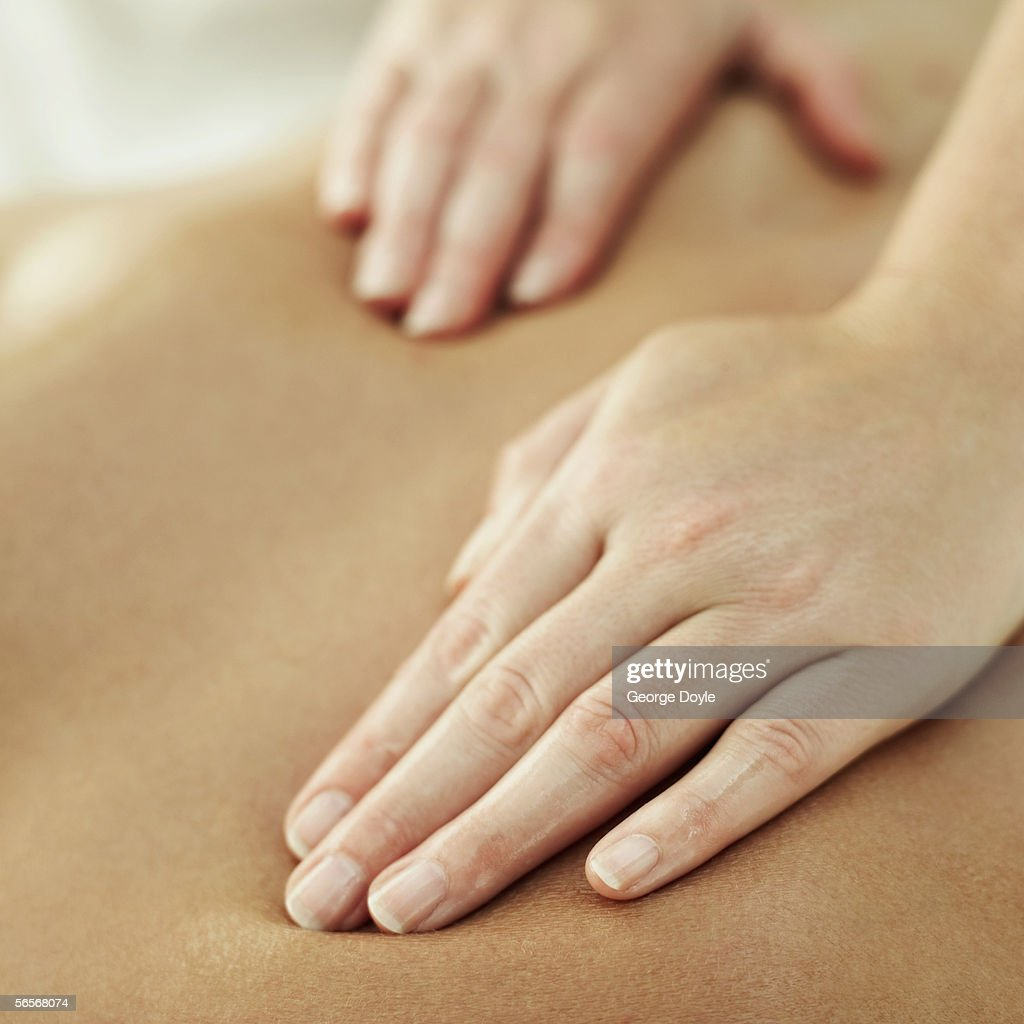 close-up of a person getting a back massage : Stock Photo